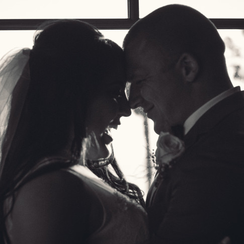 Happy bride and groom after wedding ceremony. Black and white photo. Finally Forever Photography