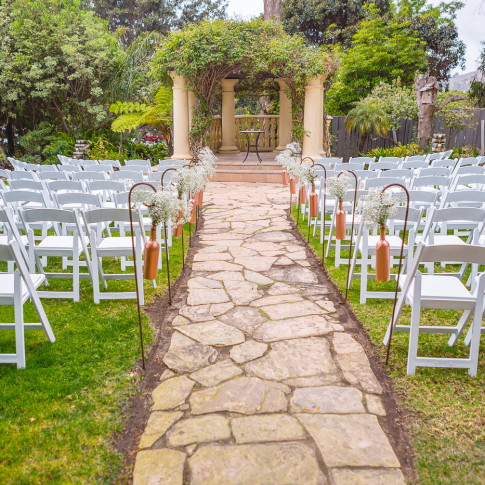 Outdoor wedding ceremony setup at the Pierpont Inn in Ventura, ca. Finally Forever Photography