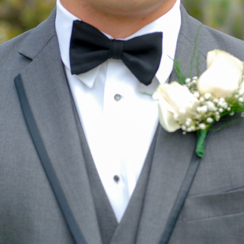 Groom's black bowtie with grey suit at a beautiful outdoor wedding in Ventura, CA.