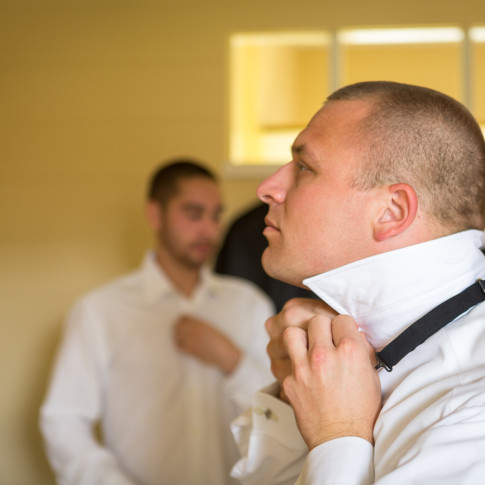Cool Groom Getting Ready putting on his Tie