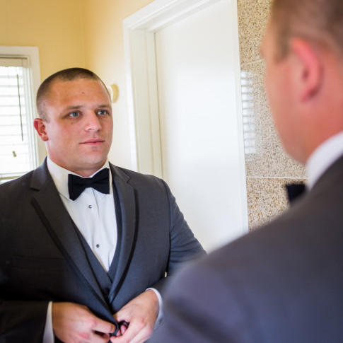 James Bond Groom looking in the mirror before getting Married