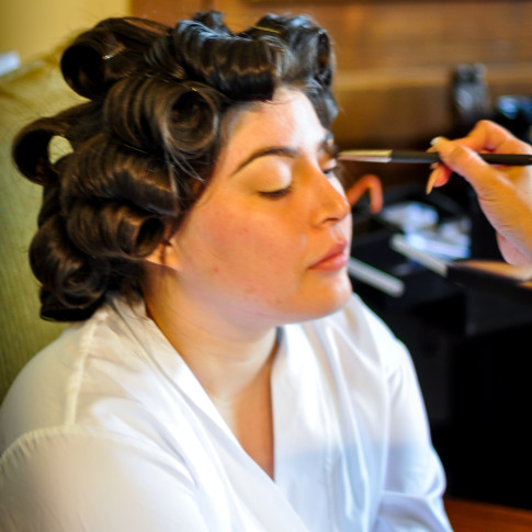 Bride getting her makeup done before wedding ceremony. Finally Forever Photography