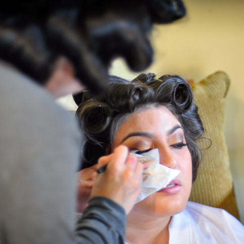 Bride getting ready before wedding ceremony. Finally Forever Photography