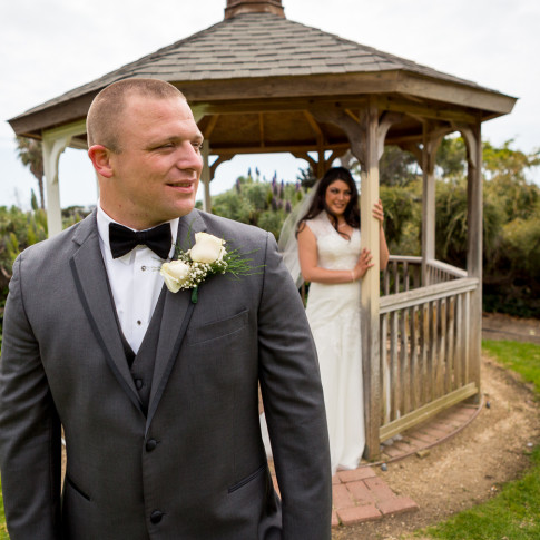Bride and groom posing by gazebo. Finally Forever Photography