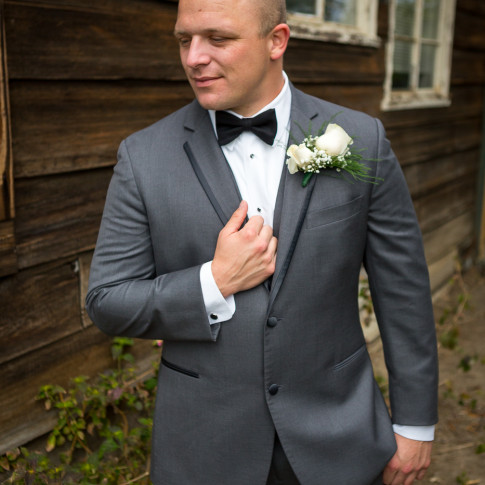 Groom in grey suit before wedding ceremony. Finally Forever photography