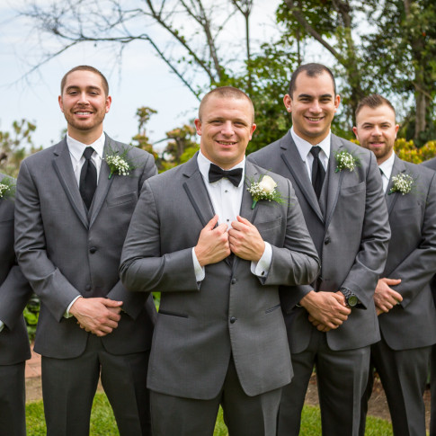 Groom with groomsmen in grey suites at an outdoor wedding ceremony. Finally Forever Photography