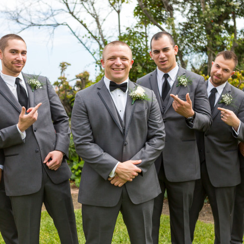 Groom with groomsmen posed for photos before wedding ceremony. Finally Forever Photography