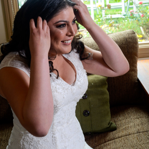 Beautiful bride getting ready before wedding ceremony. Finally Forever Photography