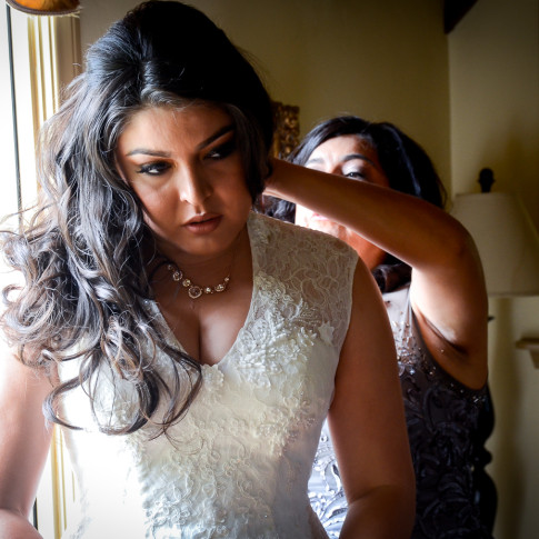Mother helping bride get ready before wedding ceremony. Finally Forever Photography