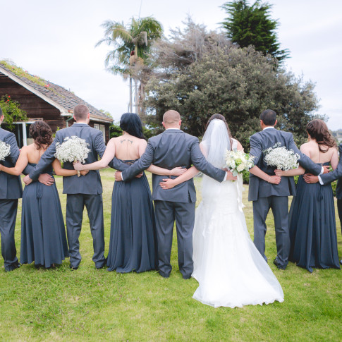 Full wedding party at a beautiful outdoor wedding location. Finally Forever Photography