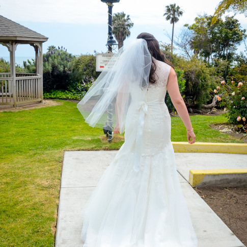 Stunning bride walking to groom during first look before wedding ceremony. Finally Forever photography.