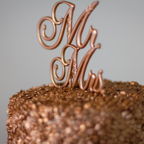 Bronze Mr and Mrs cake topper at the Pierpont Inn in Ventura, ca.