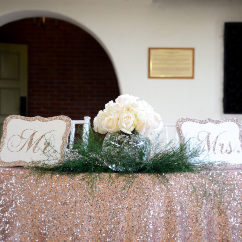 Bride and groom table at a wedding reception at the Pierpont Inn in Ventura, CA.
