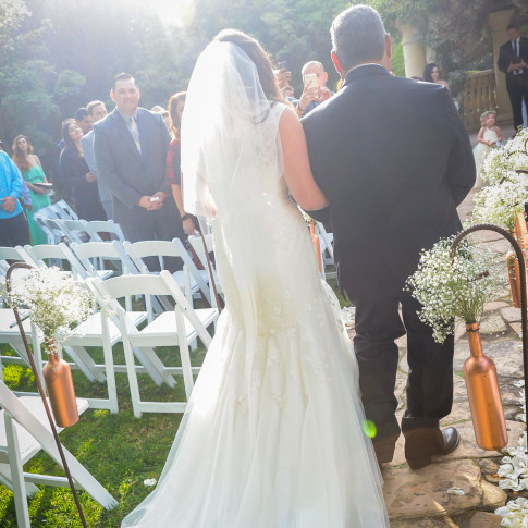Father walking bride down the aisle at a beautiful outdoor wedding at the Pierpont Inn in Ventura, ca.
