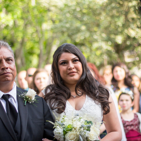 Bride and father after walking down the aisle at a beautiful outdoor wedding Pierpont Inn in ventura, ca.