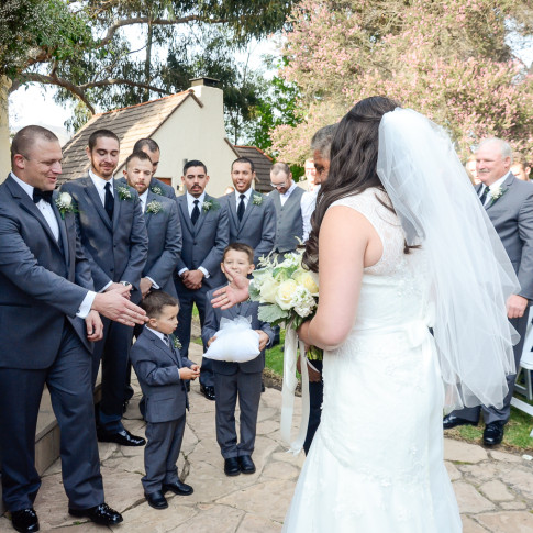 Groom and father of bride shaking hand at The Pierpont Inn in Ventura, ca.