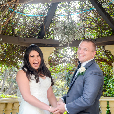Very happy bride and groom at their beautiful outdoor wedding ceremony in ventura, ca.