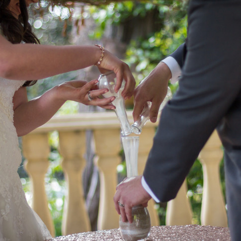 The mixing of sand at a beautiful outdoor ceremony at the Pierpont Inn in Ventura, ca.