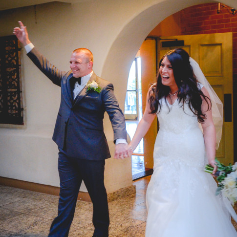 Couple walk into their wedding reception at the pierpont Inn, Ventura, CA.