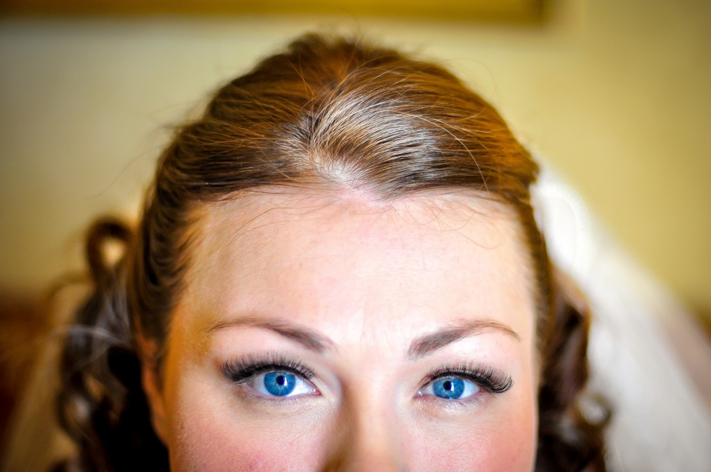 Bride's beautiful blue eyes before wedding ceremony