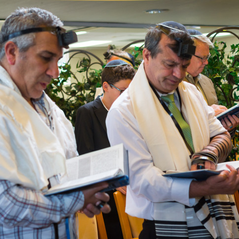 Men reading at bar mitzvah ceremony