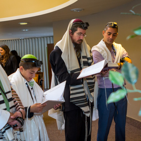 Rabbi reading at bar mitzvah ceremony